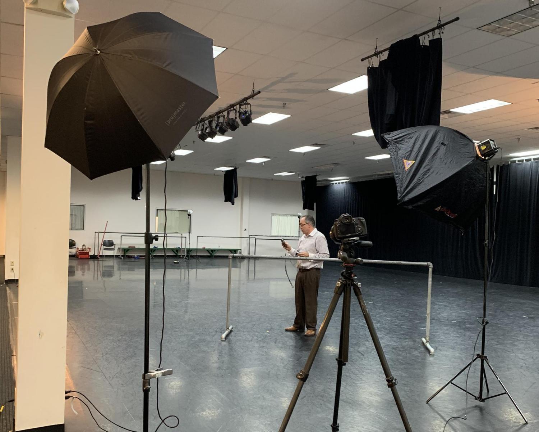 Photographer assembling a photo shoot setup