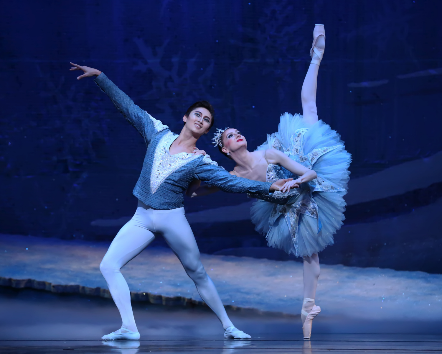 Snow Queen in penche while partnering with the Snow Prince in The Nutcracker