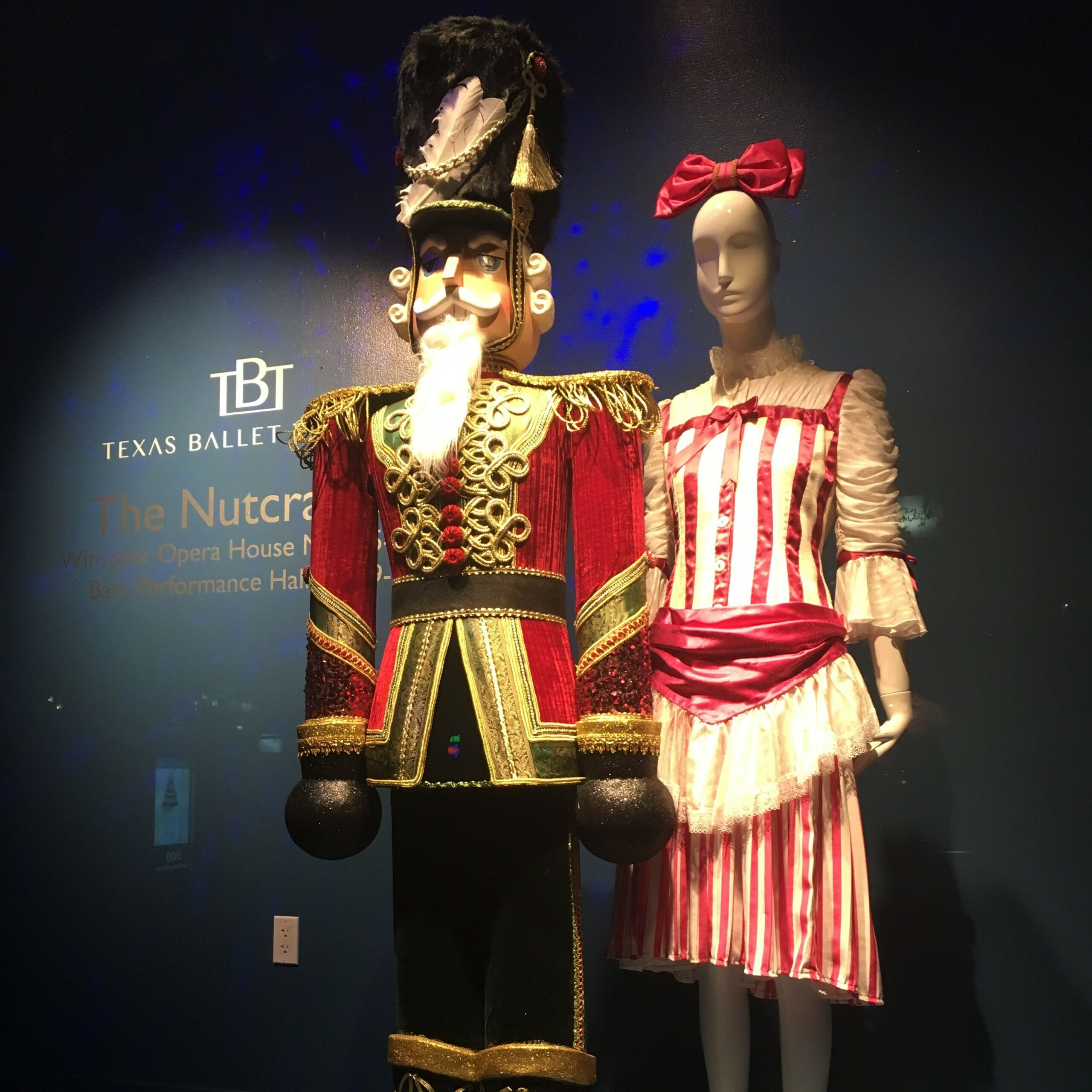 Two costumes in window