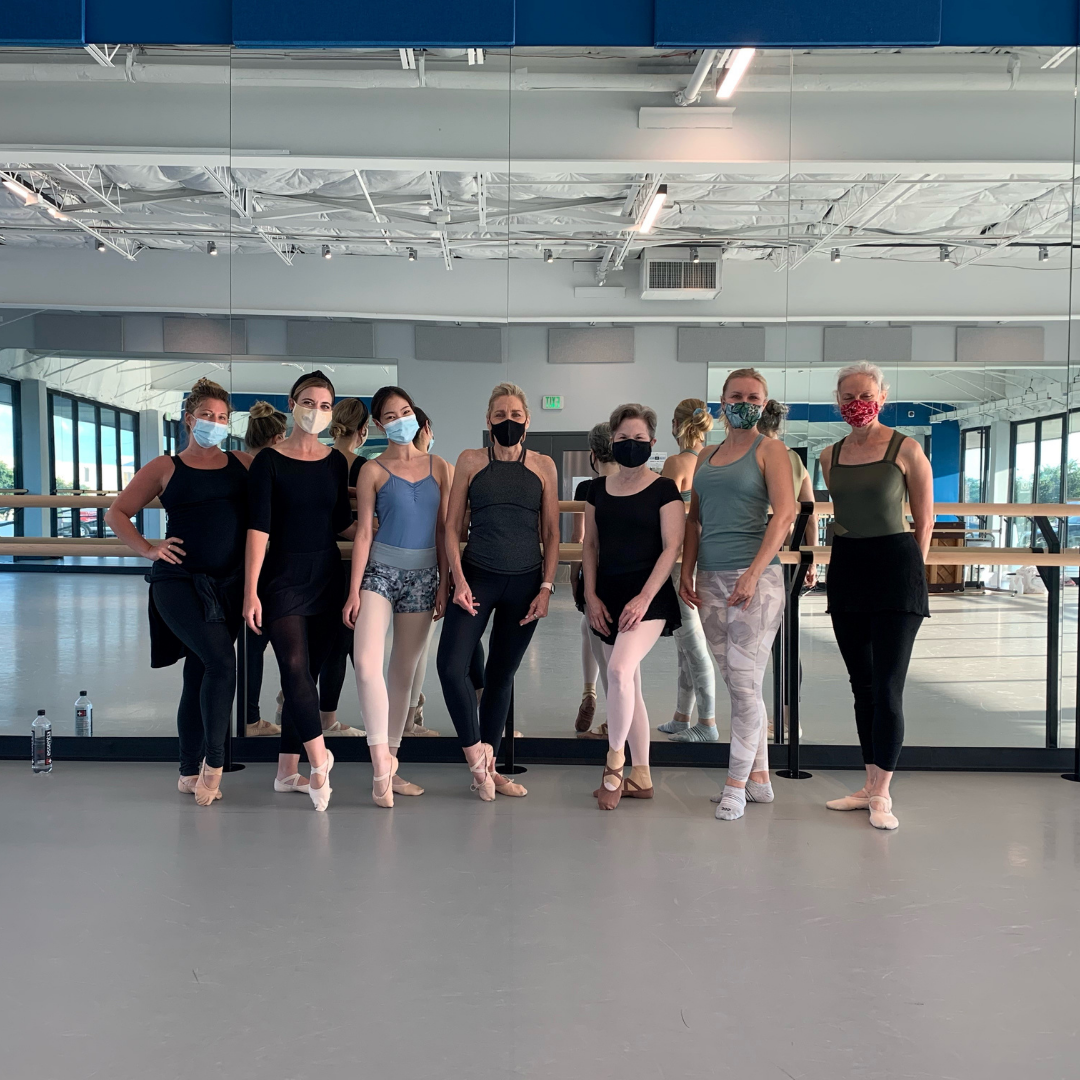 Seven female dancers in studio